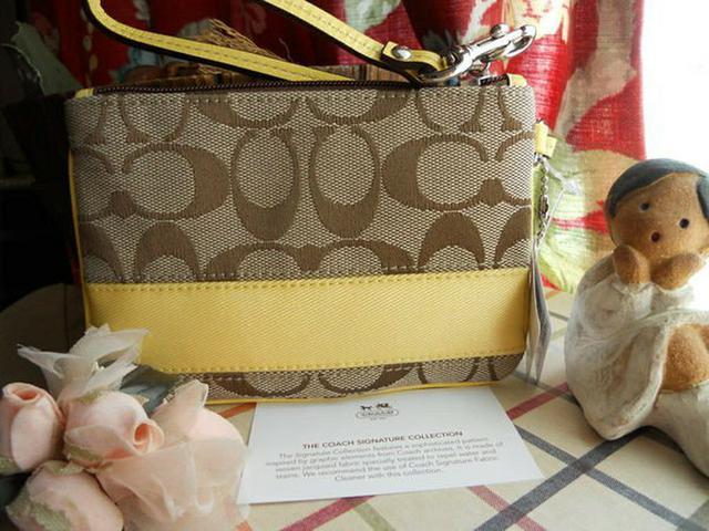 全新真品 Coach 42618 經典大C織布粉黃色系手拿包