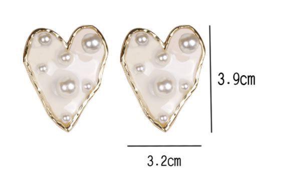(預購e) 楊丞琳同款 東大門個性誇張愛心款透明珍珠耳環